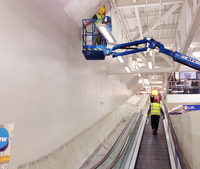 Commercial Painting inside Tesco with crane